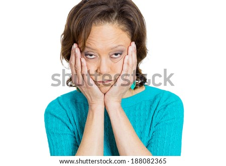 Closeup portrait, sad, alone, dark, gloomy, frustrated, stressed senior mature woman, resting chin on hands, having really bad nightmare day. Negative human emotion facial expression feelings. - stock photo
