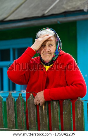 Closeup portrait sad, senior, elderly woman, grey hair on porch of her house, thoughtful, looking at you as if she is waiting for someone. Human emotions, facial expressions, life perception, reaction - stock photo
