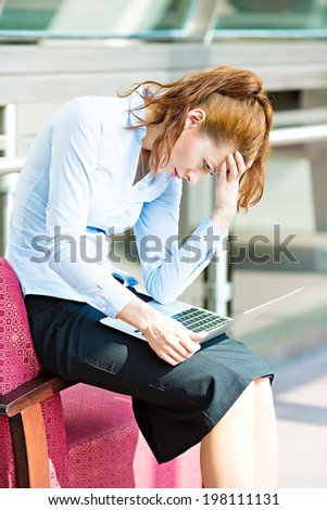 Closeup portrait sad stressed, tired, overwhelmed business woman sitting on armchair, looking at screen her laptop computer isolated background corporate office. Company employee mental health concept - stock photo