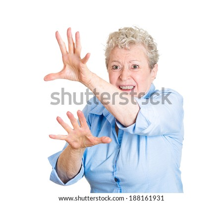 Closeup portrait, scared senior mature, woman raising hands up in defense, about to be attacked, avoiding unpleasant situation, isolated white background. Negative emotion facial expression feelings