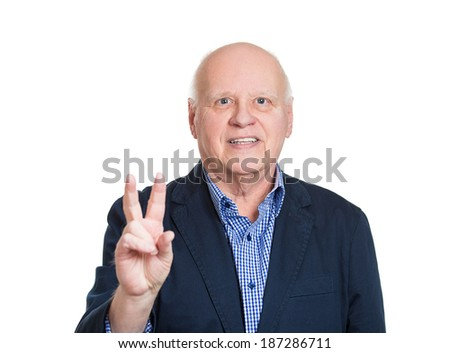 Closeup portrait, senior, bald, smiling business man, holding up peace, victory, two sign, isolated white background. Positive emotion, facial expressions, symbol, attitude communication. Life success - stock photo