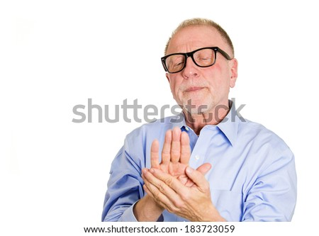 Closeup portrait, senior crazy, perfectionist, geriatric man, funny nerd black glasses, anxiously staring at fingernails, making sure they clean isolated white background. Face expression emotions - stock photo