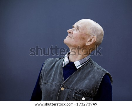 Closeup portrait senior, elderly, mature man, grandfather looking up with hope, thinking, daydreaming, isolated black background. Human facial expressions, emotions, feelings, reaction life perception - stock photo