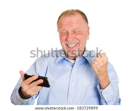 Closeup portrait, senior man, looking happy, excited at something on a cell phone, watching sports game match or reading an sms, e-mail, viewing latest news, isolated white background. - stock photo