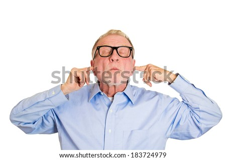Closeup portrait, senior man, nerd black glasses, covering closed ears, annoyed by loud noise or ignoring someone, not wanting to hear their side of story, isolated white background. Negative emotion - stock photo