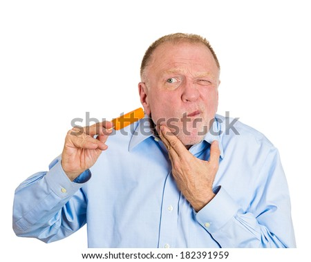 Closeup portrait senior man with sensitive tooth ache problem pain from cold frozen popsicle ice cream, hand on mouth, isolated white background. Negative human emotion, facial expressions, feelings