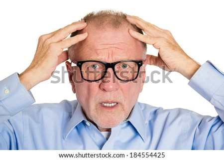 Closeup portrait, senior mature business man in black glasses, confused, troubled, deep thought, isolated white background. Human emotions, facial expressions, life perception, aging, depression - stock photo