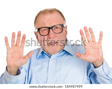 Closeup portrait, senior mature business man in glasses telling you to slow down, no stop right there, with hands in air, isolated white background. Negative human emotion, facial expression, feelings - stock photo