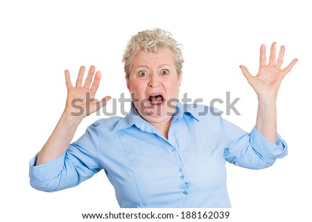 Closeup portrait, senior mature business woman looking shocked, surprised in full disbelief, hands in air, isolated white background. Negative human emotions, facial expressions, feelings, reaction - stock photo