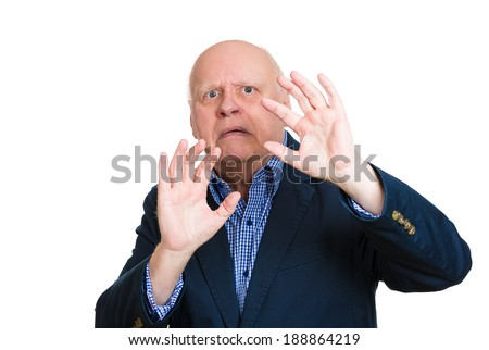 Closeup portrait, senior mature man, looking shocked, scared trying to protect himself in anticipation of unpleasant situation, isolated white background. Negative emotion facial expression feeling - stock photo