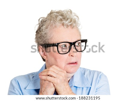 Closeup portrait, senior mature woman with big black glasses frames, looking sideways worried, hands on face, paranoid, isolated white background. Positive human emotions, facial expressions feelings - stock photo