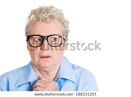 Closeup portrait, senior mature woman with big black glasses frames, looking sideways worried, hands on chest, paranoid, isolated white background. Positive human emotions, facial expressions feelings - stock photo