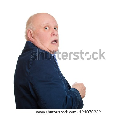 Closeup portrait, senior, scared, afraid, old man, citizen, employee, full of fear on run, chased by someone, isolated white background. Human face expressions, emotions, reaction, feelings, attitude - stock photo