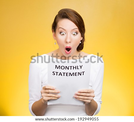 Closeup portrait shocked, funny looking business woman, disgusted at monthly statement, can't believe her eyes, isolated yellow background. Negative human emotion, facial expression, feeling. Bad news - stock photo