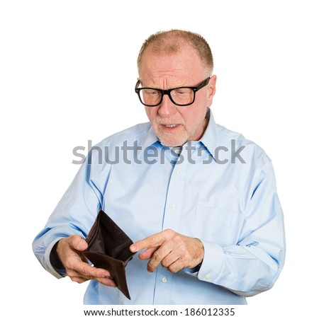 Closeup portrait, shocked, surprised, speechless business senior mature man, worker, employee, holding empty wallet, isolated white background. Bankruptcy, financial difficulty. Human face expression - stock photo