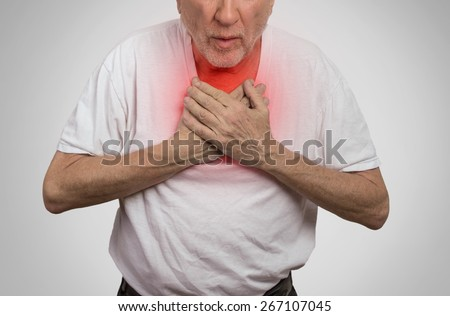 Closeup portrait sick old man, elderly guy, having severe infection, chest pain, looking miserable unwell, trying to catch his breath isolated on gray background. Geriatric health care concept  - stock photo