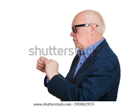 Closeup portrait, side headshot senior crazy perfectionist, geriatric man, funny nerd black glasses, anxiously staring at fingernails, making sure they clean isolated white background. Face expression - stock photo