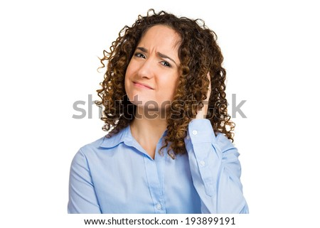 Closeup portrait skeptical, upset young woman looking suspicious, disgust on face, mixed disapproval, judgement isolated white background. Negative human emotion, facial expression, feeling, attitude - stock photo