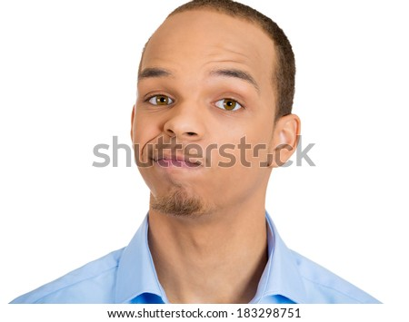 Closeup portrait skeptical young man, funny, suspicious annoyed looking man, being cautious, careful, alert, attentive, thinking, on his own mind isolated white background. Emotion, facial expression