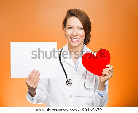 Closeup portrait smiling, cheerful health care professional, pharmacist, dentist, nurse, cardiologist doctor with stethoscope, holding heart, blank white paper, copy space, isolated orange background. - stock photo