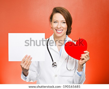 Closeup portrait smiling, cheerful health care professional, pharmacist, dentist, nurse, cardiologist doctor with stethoscope, holding heart, blank white paper, copy space, isolated red background. - stock photo