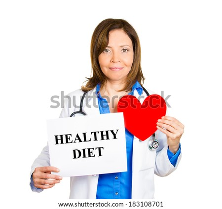 Closeup portrait smiling female health care professional, woman family doctor, cardiologist with stethoscope holding sign, healthy diet, red heart isolated white background. Patient treatment plan - stock photo