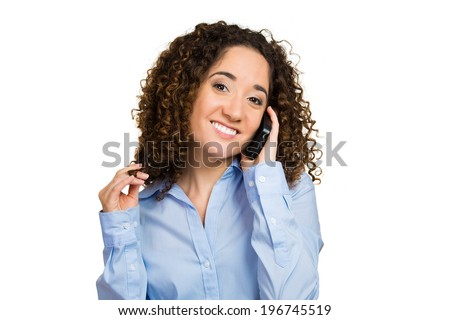 Closeup portrait, smiling, happy woman, employee using cell phone, having pleasant conversation, twirling hair, isolated white background. Human facial emotions, expression, reaction, body language - stock photo