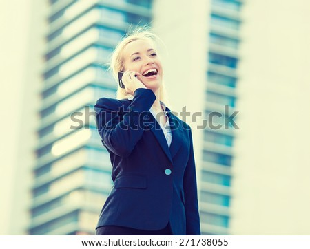 Closeup portrait, smiling, laughing  attractive successful businesswoman, entrepreneur, corporate employee talking on cellphone while walking on street, isolated background office, company building - stock photo
