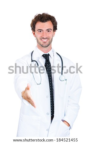 Closeup portrait, smiling young male doctor with stethoscope,casual hand in pocket, giving handshake, isolated white background. Patient doctors visit and health care plan. Cardiology appointment.