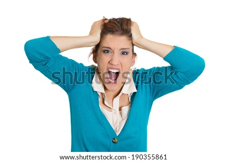 Closeup portrait stressed, angry student, woman, pulling her hair out yelling, screaming with temper tantrum, isolated white background. Negative human emotions, facial expressions, reaction attitude - stock photo