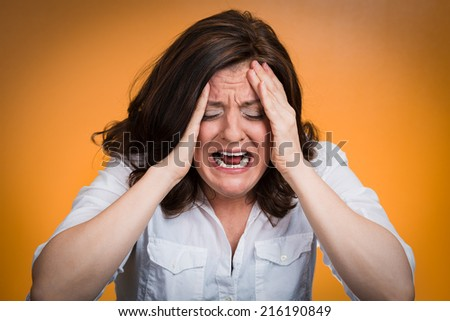 Closeup portrait stressed business woman having breakdown hysterical yelling screaming with temper tantrum isolated orange background. Negative human emotions facial expressions reaction attitude - stock photo