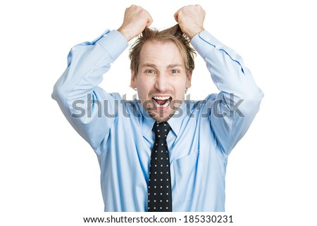 Closeup portrait, stressed, frustrated, crazy man, pulling his hair out, having panic attack, isolated white background. Negative human face expressions, emotions, feelings, attitude, perception - stock photo