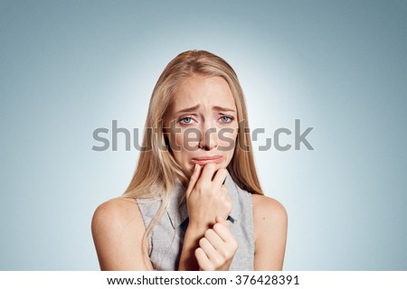 Closeup portrait stressed frustrated woman crying or weep having temper tantrum isolated on wall background. Negative human emotion facial expression reaction attitude - stock photo