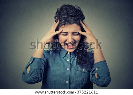 Closeup portrait stressed frustrated young woman yelling screaming having temper tantrum isolated on gray wall background. Negative human emotion facial expression reaction attitude  - stock photo