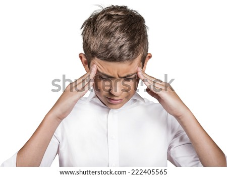 Closeup portrait stressed sad teenager boy hands on temples, head spinning around, overwhelmed at school in life isolated white background. Negative human facial expression emotion feeling, perception - stock photo