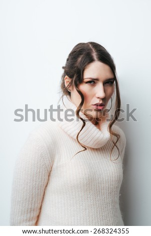 Closeup portrait stressed sad young , woman, employee having migraine, tension headache  grey wall background. Human face expression emotion reaction, attitude - stock photo