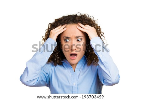 Closeup portrait, stressed, sad young woman, employee, worker, student having bad migraine, tension headache, isolated white background. Negative human face expressions, emotions, reaction, attitude - stock photo