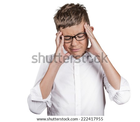 Closeup portrait stressed teenager boy hands on temples, head spinning around, overwhelmed at school in life isolated white background. Negative human facial expressions, emotions, feeling, perception - stock photo