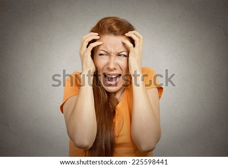 Closeup portrait stressed upset woman having breakdown hysterical yelling screaming temper tantrum isolated orange background. Negative human emotion facial expression reaction attitude body language - stock photo