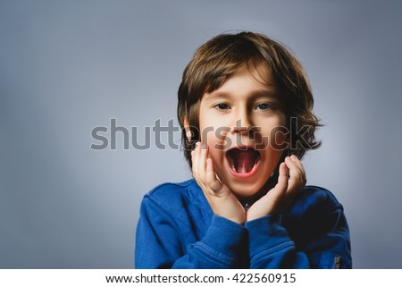 Closeup portrait successful happy boy isolated grey background. Positive human emotion face expression. Life perception achievement vision - stock photo