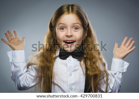 Closeup portrait successful happy girl going surprise isolated on gray background. Positive human emotion face expression. Life perception achievement vision - stock photo