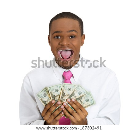 Closeup portrait super happy, excited, successful young man holding money dollar bills in hand isolated white background. Positive emotion, facial expression feeling reaction. Financial reward savings - stock photo