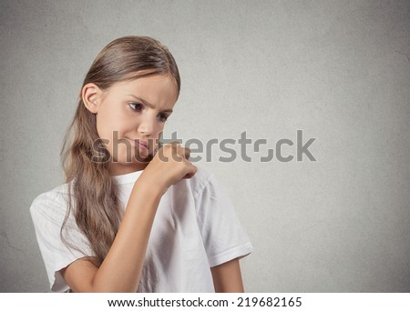 Closeup portrait teenager girl opening t-shirt to vent, its hot blowing air, unpleasant, awkward situation embarrassment isolated grey wall background. Negative human emotion facial expression feeling - stock photo