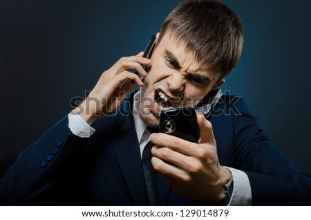 closeup portrait  the  beautiful  businessman careerist in costume,  call and angry cry - stock photo