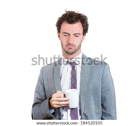 Closeup portrait tired, falling asleep business man in blue shirt holding cup coffee, struggling not to crash, stay awake, keep eyes opened isolated white background. Human emotion, facial expressions - stock photo