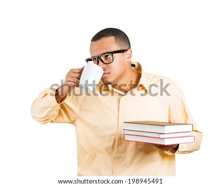 Closeup portrait tired, young man, student holding books, cup coffee falling asleep, trying to keep eyes open isolated white background. Human emotion, facial expressions, sleep deprivation, busy day - stock photo