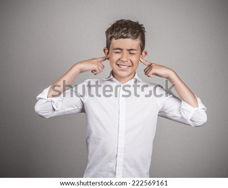 Closeup portrait unhappy, annoyed young man plugging closing ears with fingers disgusted ignoring something not wanting to hear someone side story isolated grey background. Human emotion body language - stock photo