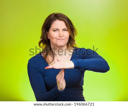 Closeup portrait, unhappy attractive young serious woman showing time out gesture with hands isolated green background. Negative human emotion, facial expressions, sign symbol, body language, attitude - stock photo