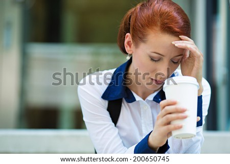 Closeup portrait unhappy business woman, head on hand sitting on stairs, bothered by mistake, having bad headache isolated background corporate office windows. Negative human emotion facial expression - stock photo