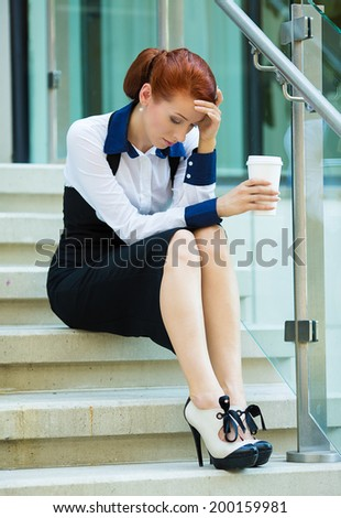 Closeup portrait unhappy business woman, head on hand sitting on stairs bothered by mistake having bad headache isolated background outside corporate office. Negative human emotions, facial expression - stock photo
